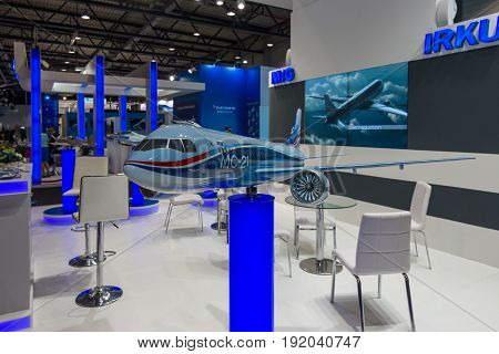 BERLIN GERMANY - JUNE 01 2016: The stand of Unated Aircraft Corporation (Russia). Model of Russian jet airliner Irkut MC-21. Exhibition ILA Berlin Air Show 2016