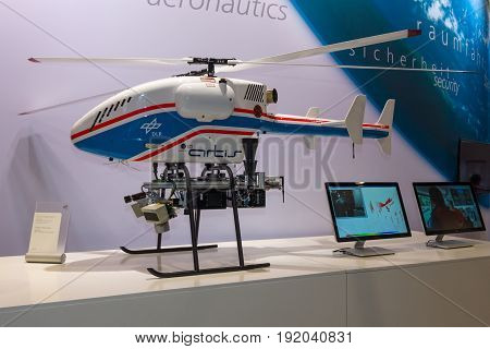 BERLIN GERMANY - JUNE 01 2016: The stand of German Aerospace Center (DLR). Helicopter Drone SuperARTIS (Autonomous Rotorcraft Testbed for Intelligent Systems). Exhibition ILA Berlin Air Show 2016.