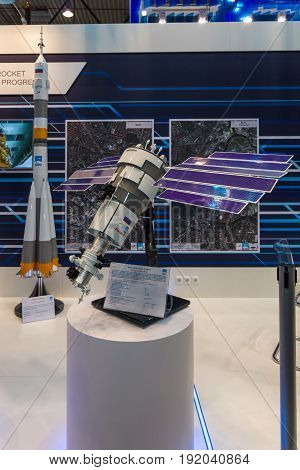 BERLIN GERMANY - JUNE 01 2016: The stand of State Space Corporation - Roscosmos (Russia). Model of satellite Resurs-P. Exhibition ILA Berlin Air Show 2016.