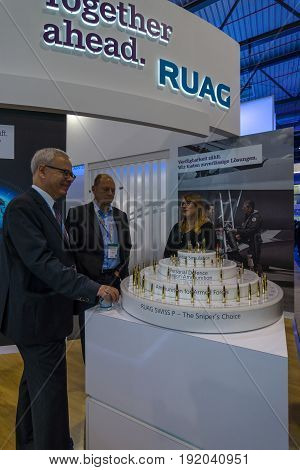 BERLIN GERMANY - JUNE 01 2016: The stand the company RUAG Ammotec manufacturer of small arms ammunition up to 12.7 mm for defence law enforcement hunting and sport. Exhibition ILA Berlin Air Show 2016.