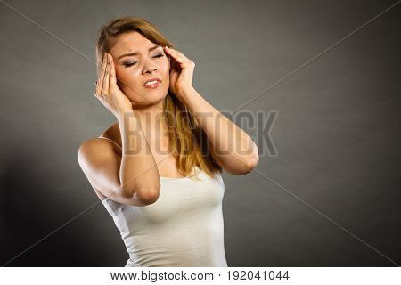 Woman Suffering From Headache Migraine Pain.