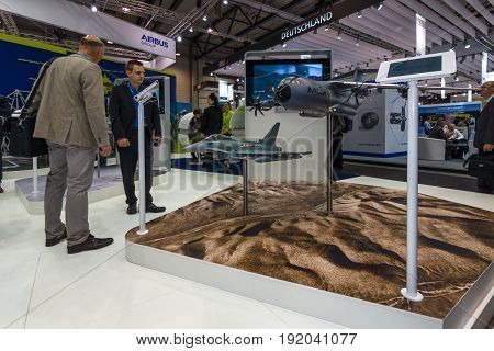 BERLIN GERMANY - JUNE 01 2016: The stand of Airbus Group. Models of military transport aircraft Airbus A400M Atlas and multirole fighter Eurofighter Typhoon. Exhibition ILA Berlin Air Show 2016.