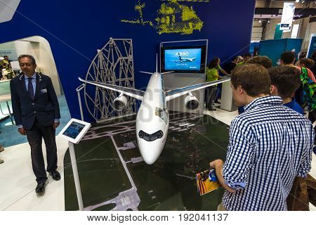 BERLIN GERMANY - JUNE 01 2016: The stand of Airbus Group. Model of passenger airliner Airbus A350-1000. Exhibition ILA Berlin Air Show 2016.