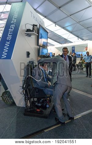 BERLIN GERMANY - JUNE 01 2016: The stand of Air Manoeuvre Training Alliance in cooperation with Thales Defence & Security Systems GmbH. Helicopter simulator. Exhibition ILA Berlin Air Show 2016.