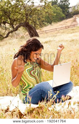 African American woman working on a computer.