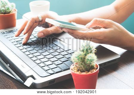 Woman using smartphone and laptop Startup SME concept
