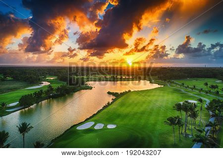 Aerial view of tropical golf course at sunset Dominican Republic Punta Cana