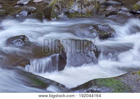 Rushing river water flowing over rocks in Oregon