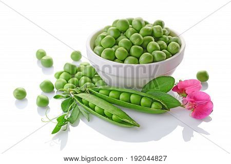 Healthy Food. Fresh Green Peas In White Bowl With Pink Flowers Of Sweet Pea
