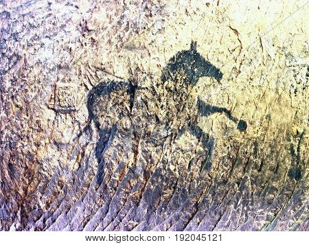 Old Cave. Black Paint Of Horses On Sandstone Wall,