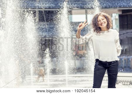 Pretty Girl Plays With Splashes Of Water