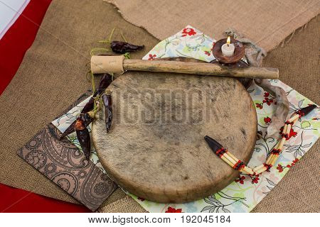 Various djembes and tambourine in front of a rustic wall
