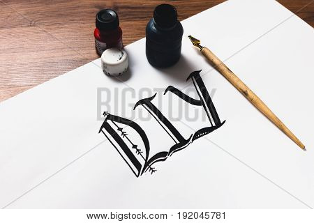 Calligraphy painter workplace. Professional equipment and DIY abbreviation made with ink top view. Artist workshop, small business inspiration, creativity concept.