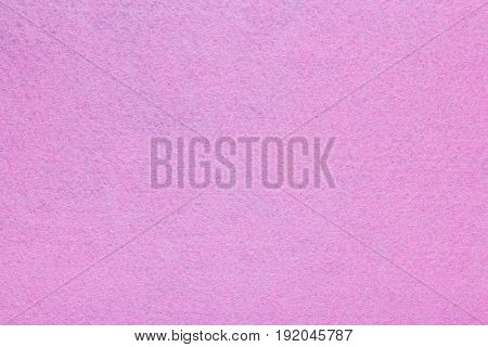 Background with pink texture velvet fabric full frame close up