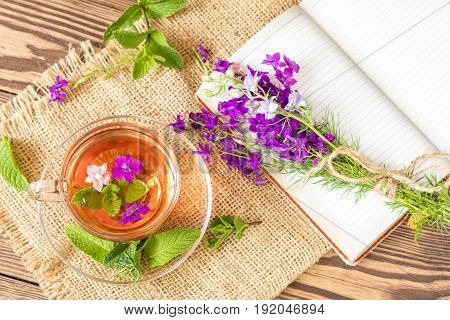 Glass Cup Of Summer Tea With Herbs