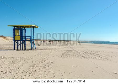 Ventspils, LV - MAY 6, 2017: Beach and lifeguard tower in sunny day
