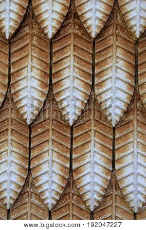 Vertical image of stone background carved in the shape of leaves