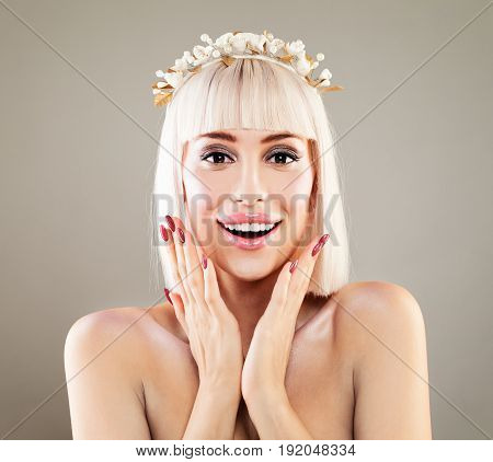 Happy Surprised Woman with Open Mouth. Laughing Fashion Model with Makeup Blonde Bob Hairstyle and Manicure Surprise Concept