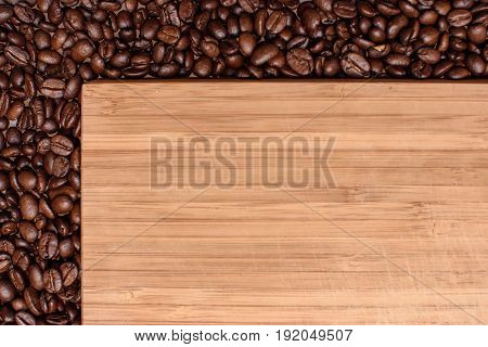 A Wooden Background Around The Edges Sprinkled With Roasted Grain Coffee, Space For Text