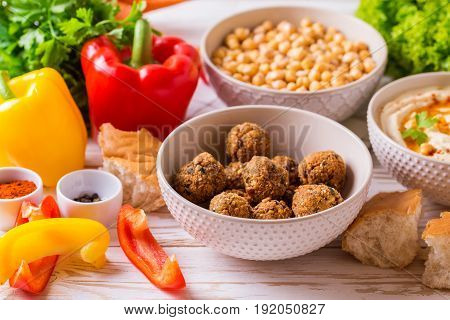 Falafel, Pita, Hummus And Chickpea  With Vegetables. Horizontal View