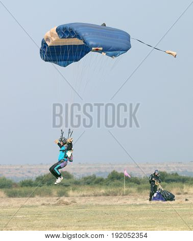 Male Skydiver Coming In For Fast Landing On Grass (landing Series Image 1 Of 4).