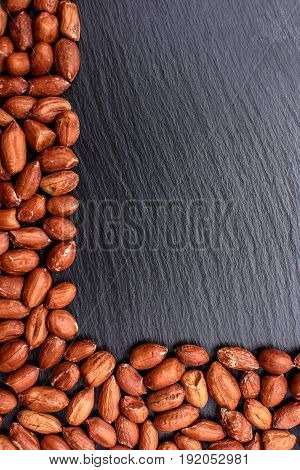 Roasted Peanuts Peeled On A Black Stone Board, Space For Text