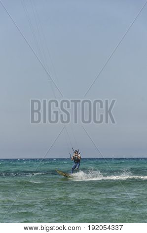 Porto Paglia Italy - October 03 2016: Senior keeps active by practicing water sport in Sardinia