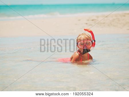 cute little girl learning to swim with diving mask
