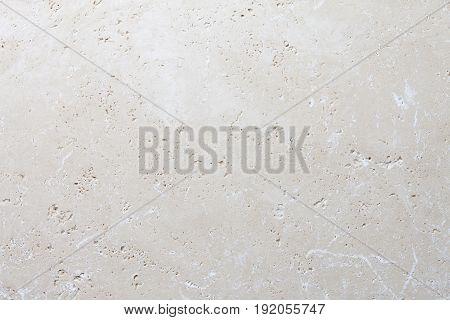Beige stone background, natural travertine texture close up