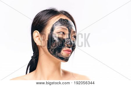 Woman in cosmetic mask on isolated background.