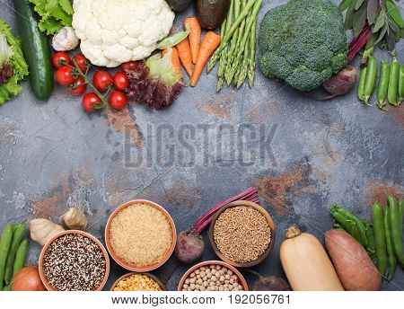 Above view of different vegetables and grains, arranged in a circle with copy space in the middle, broccoli, squash, beans, tomatoes, carrots, avocado, selective focus