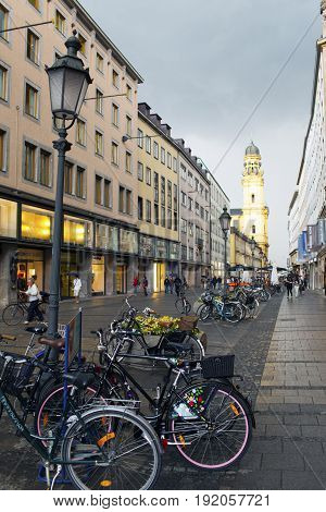 MUNICH GERMANY - May 29 2012: bicycles on the street Theatinerstrasse with view on Theatine Church of St. Cajetan (Theatinerkirche St. Kajetan)