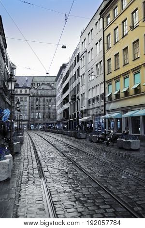 Munich. The street in the center of the old city with a stone blocks and tram ways