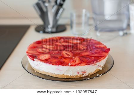 Summer homemade cheesecake with juicy strawberries side view