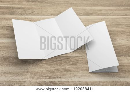 Blank opened 3D rendering tri-fold brochure mock-up with clipping path. Template on wood texture background. Composition No. 1