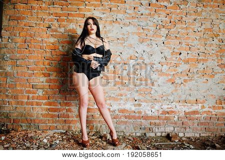 Brunette Plus Size Sexy Woman, Wear At Black Leather Jacket, Lace Panties, Bra At Abadoned Place Nea