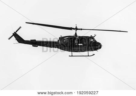 BERLIN GERMANY - JUNE 02 2016: Demonstration flight of military helicopter Bell UH-1 Iroquois. German Army. Black and white. Exhibition ILA Berlin Air Show 2016