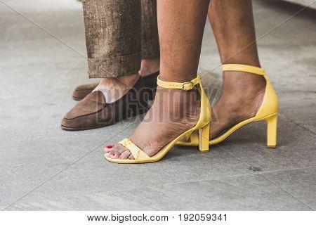 MILAN ITALY - JUNE 19: Detail of shoes outside Armani fashion show building during Milan Men's Fashion Week on JUNE 19 2017 in Milan.
