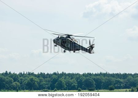 BERLIN GERMANY - JUNE 02 2016: Helicopter NH90 of the German Army. Demonstrative performance. Exhibition ILA Berlin Air Show 2016