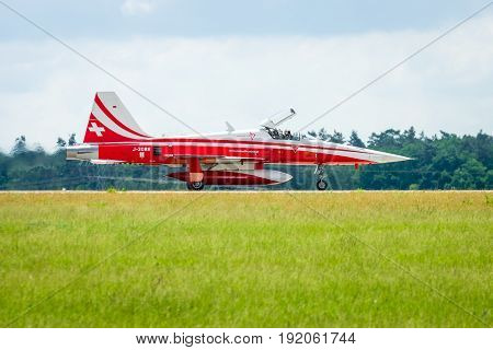 BERLIN GERMANY - JUNI 02 2016: Landing of jet Northrop F-5E Tiger II. The aerobatic team Patrouille Suisse. The pilot Captain R.Freiburghaus. Exhibition ILA Berlin Air Show 2016