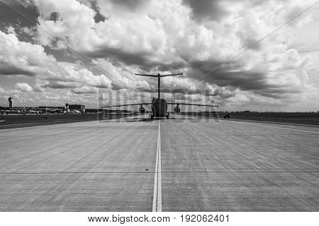 BERLIN GERMANY - JUNE 02 2016: Military transport aircraft Antonov An-178 on the taxiway. Waiting takeoff. Black and white. Exhibition ILA Berlin Air Show 2016