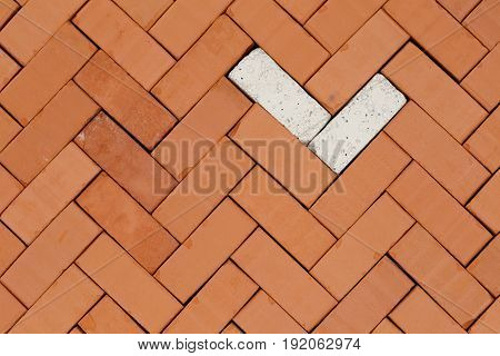 pattern with fish- bone bricks on a basement