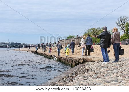 St. Petersburg Russia - 28 May, Tourists on the embankment of the Hare Island.,28 May, 2017. Famous sightseeing places of St. Petersburg for tourists.