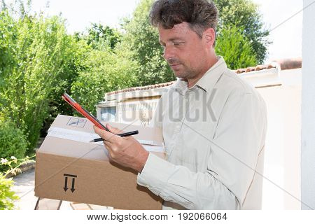 a man courier box delivery man at hom