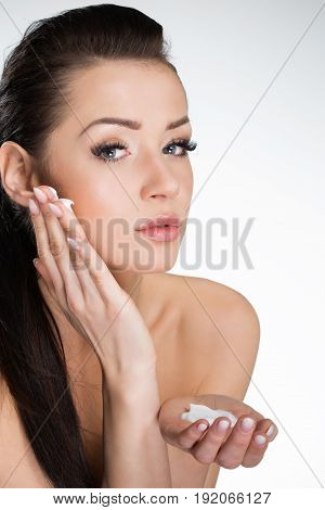 Classic Beautiful Woman Moistening Face With Cream