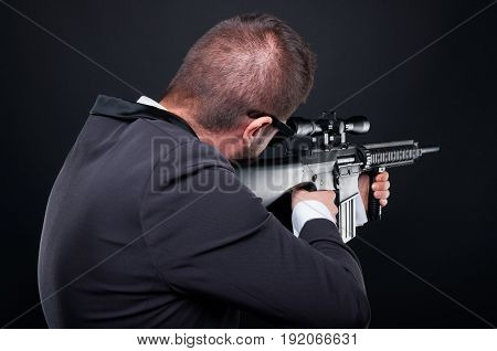 Back View Of Violent Mafia Member Aiming Rifle