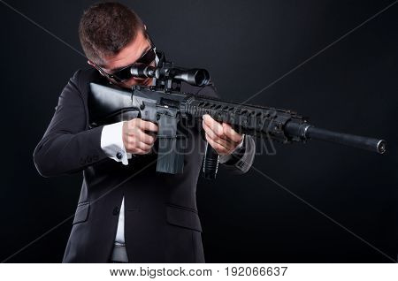 Male Gangster Aiming Machine Gun At Someone