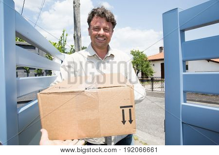 Worker Man Delivery Parcel In House Home