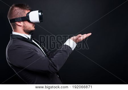 Rich Guy With Vr Glasses Holding Palms Up