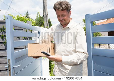 Delivery Man At Home With Parcel Order By Net